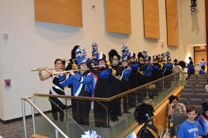 Combined high school marching bands perform the Star-Spangled Banner