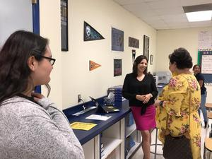 Ms. Lujan meets with parents at Open House