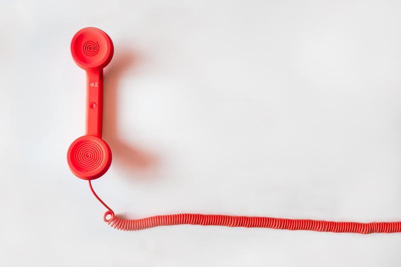 Image of a red telephone receiver