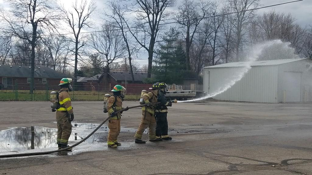 fire working with hoses