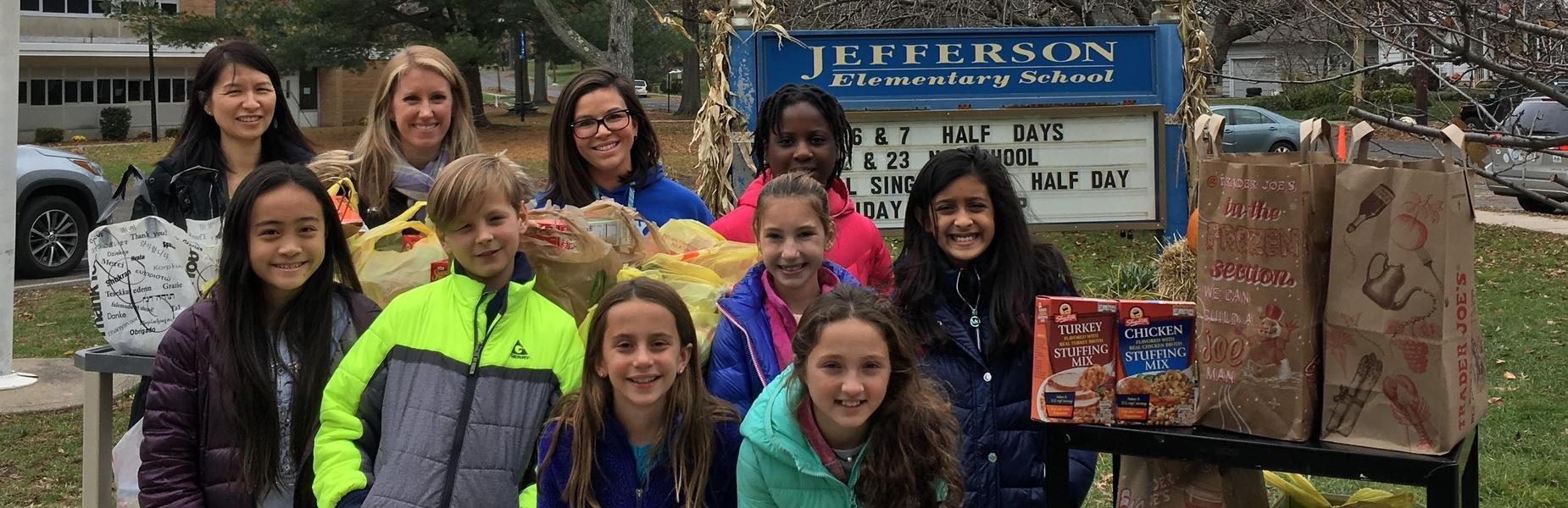 The Early Act Club of Jefferson School coordinated a food drive to help those less fortunate.  Members of the club and their advisors, along with Jefferson principal Dr. Susie Hung (upper left), delivered the food items on Nov. 20 to Grace Presbyterian Church.