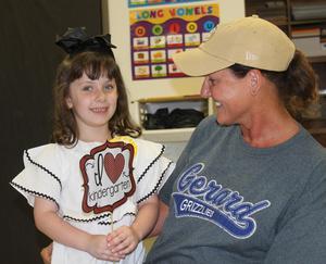 Student holding I love Kindergarten sign