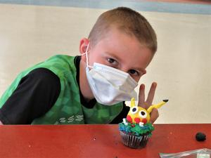 A student created Pickachu on his cupcake.