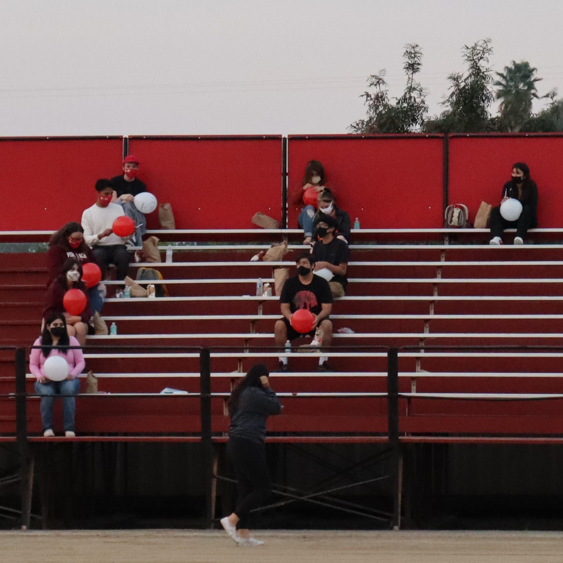 students and staff in the bleachers