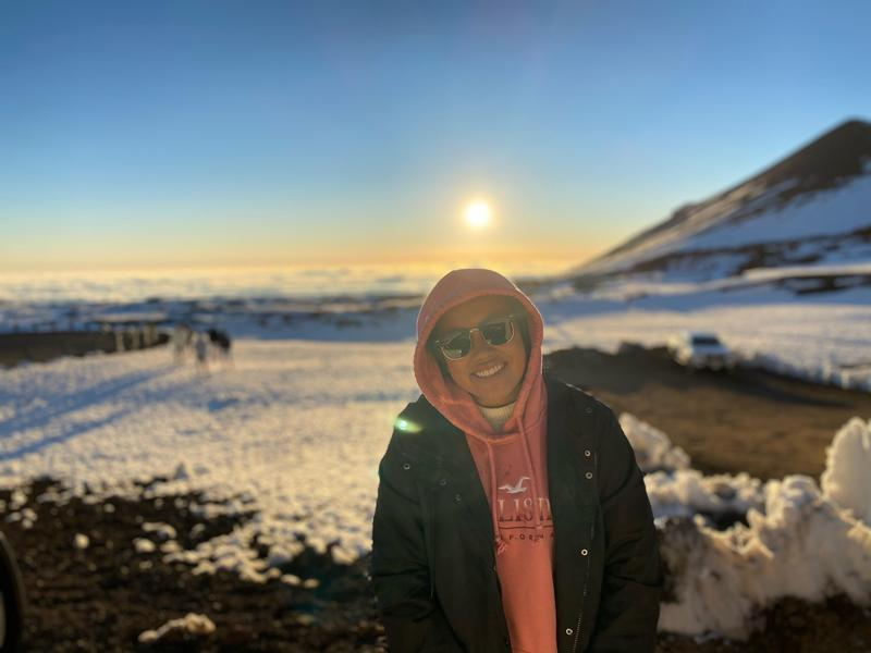 This infographic shows one of our students enjoying the snow and posing in front of a beautiful sunset