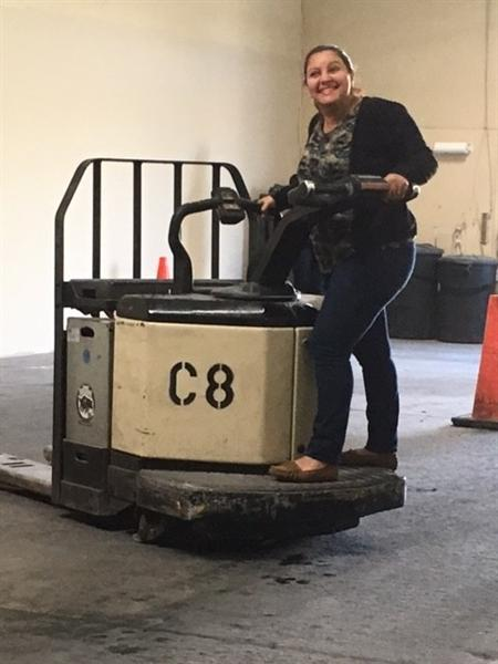 Student is driving fork lift