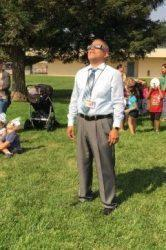 Mr. Zambrano viewing an eclipse
