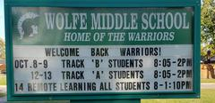 outdoor school sign with message