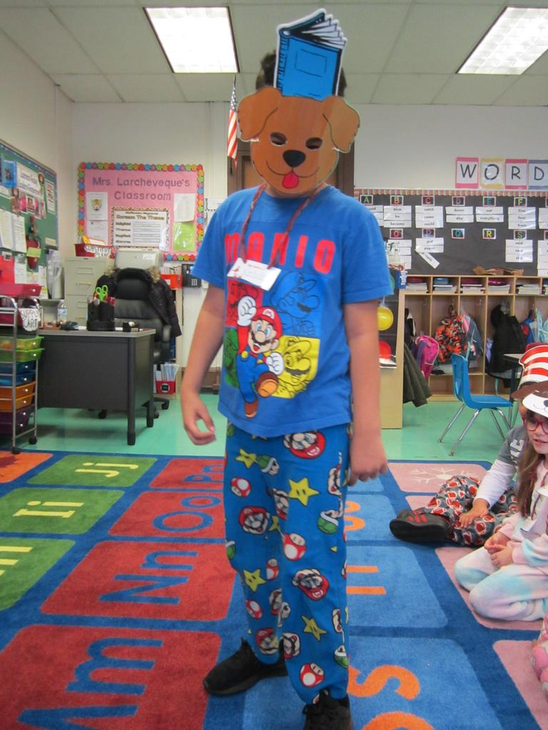 a boy wearing pj's and wearing a dog mask up close