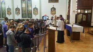 photo of the OLSH student athletes receiving a blessing