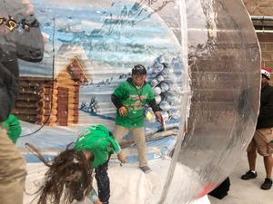 Students playing in giant snow globe, image 1