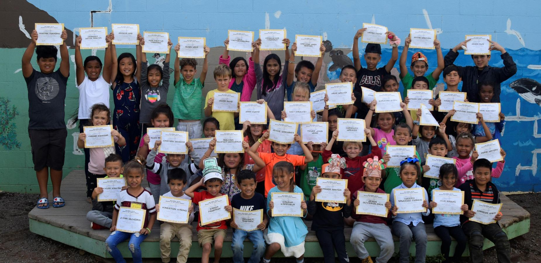 students holding perfect attendance awards