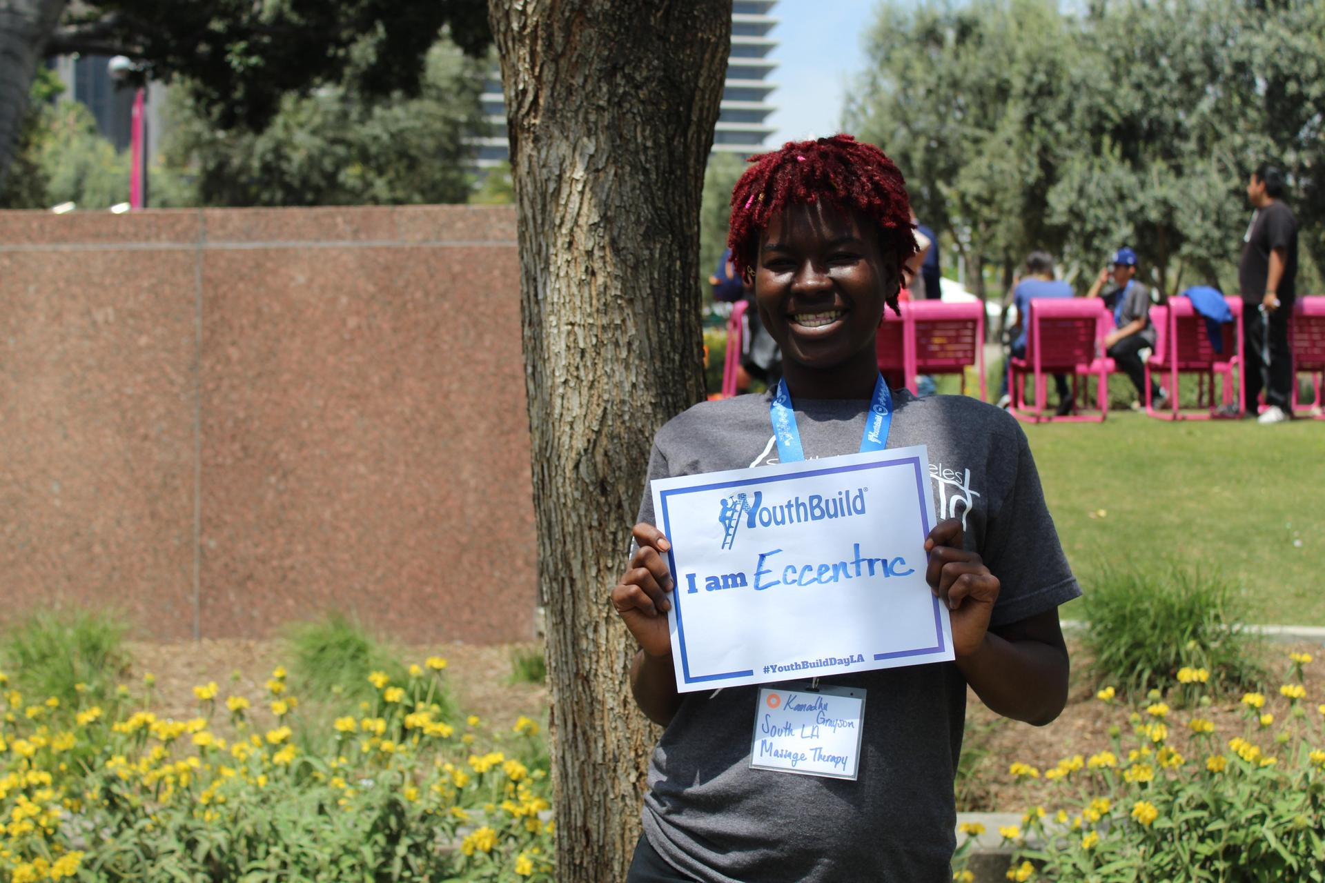 A South LA student holds a sign that says 'I am eccentric'