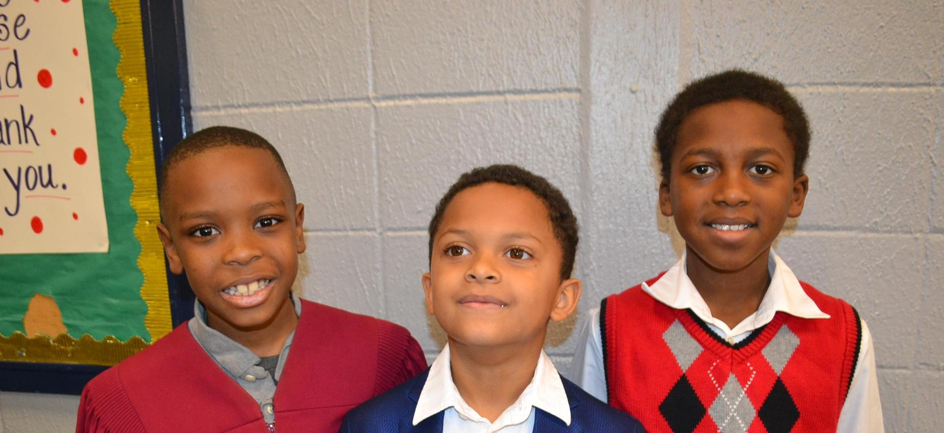 three students dressed for black history month