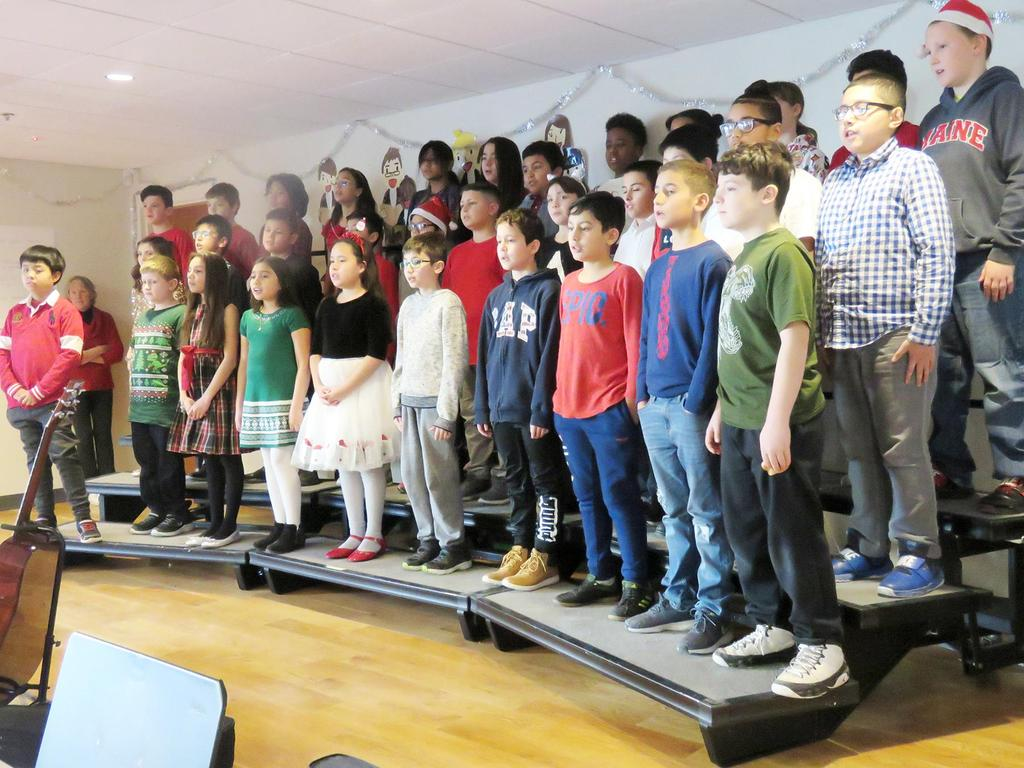 A stage full of students singing