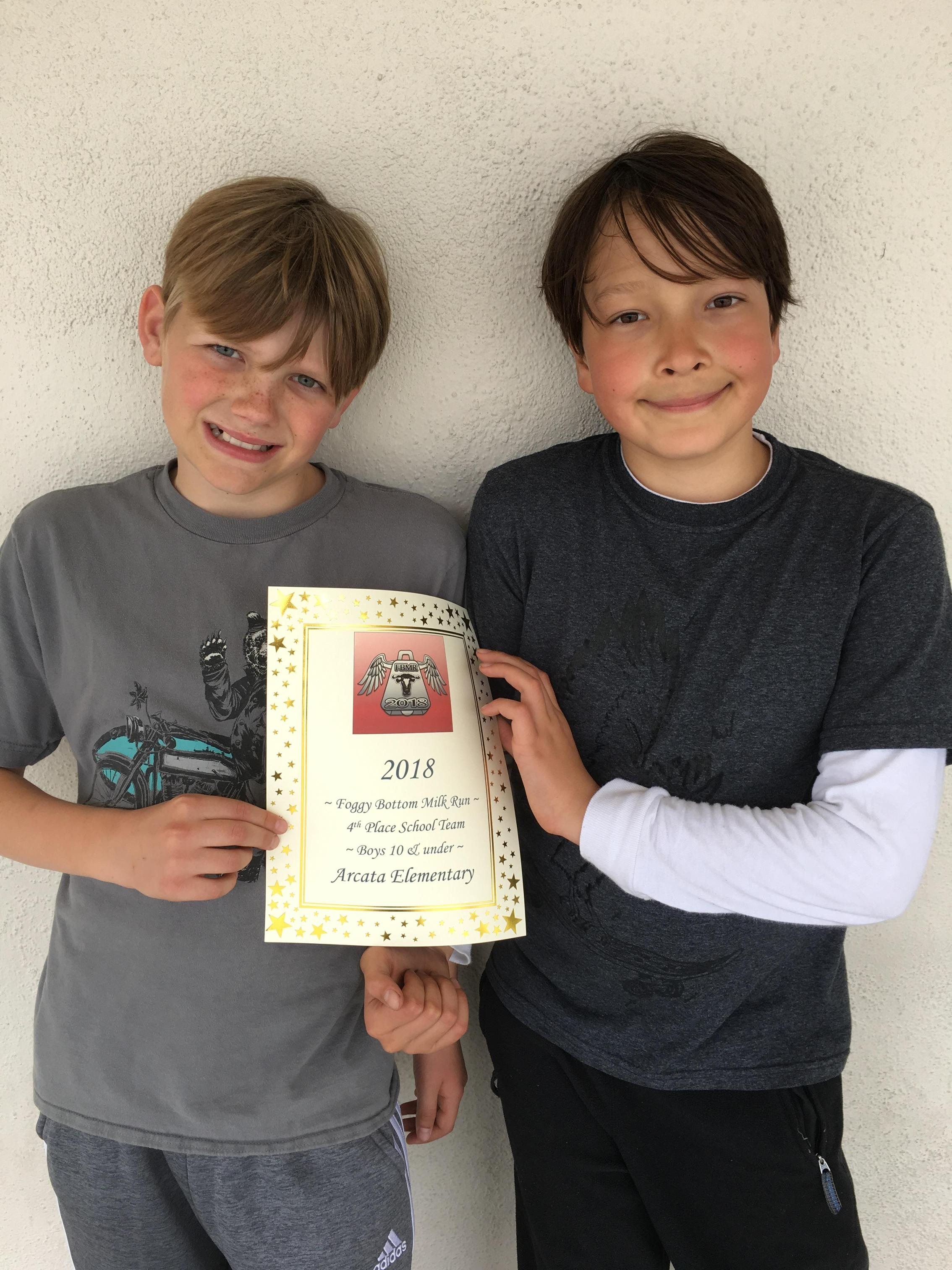 two boys with certificate