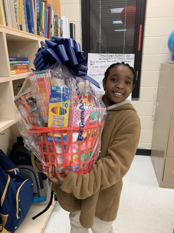 Janiya holding gift basket.
