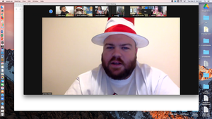 Mr. Blake wearing dr. seuss hat on zoom