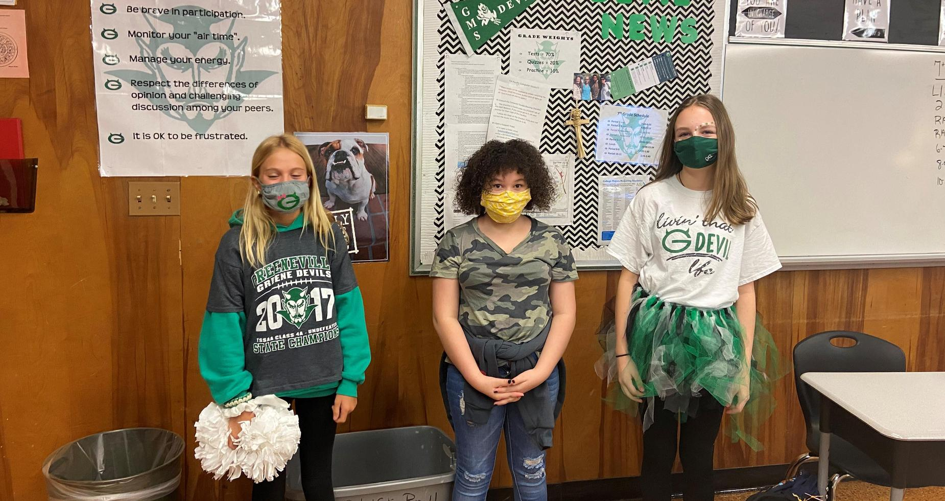 a picture of GMS students in green and white