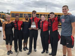 Photo of Band seniors with UIL Marching Band 1st Division trophy