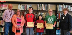 TKMS teachers Marc Lester and Rojean Sprague congraulate 8th-grade students Dylan LeClaire, MollyShepherd and Casey Lopez on their Americanism essays. Also  pictured is Alma Czinder, the Americanism chair for the Hastings Elks Lodge.