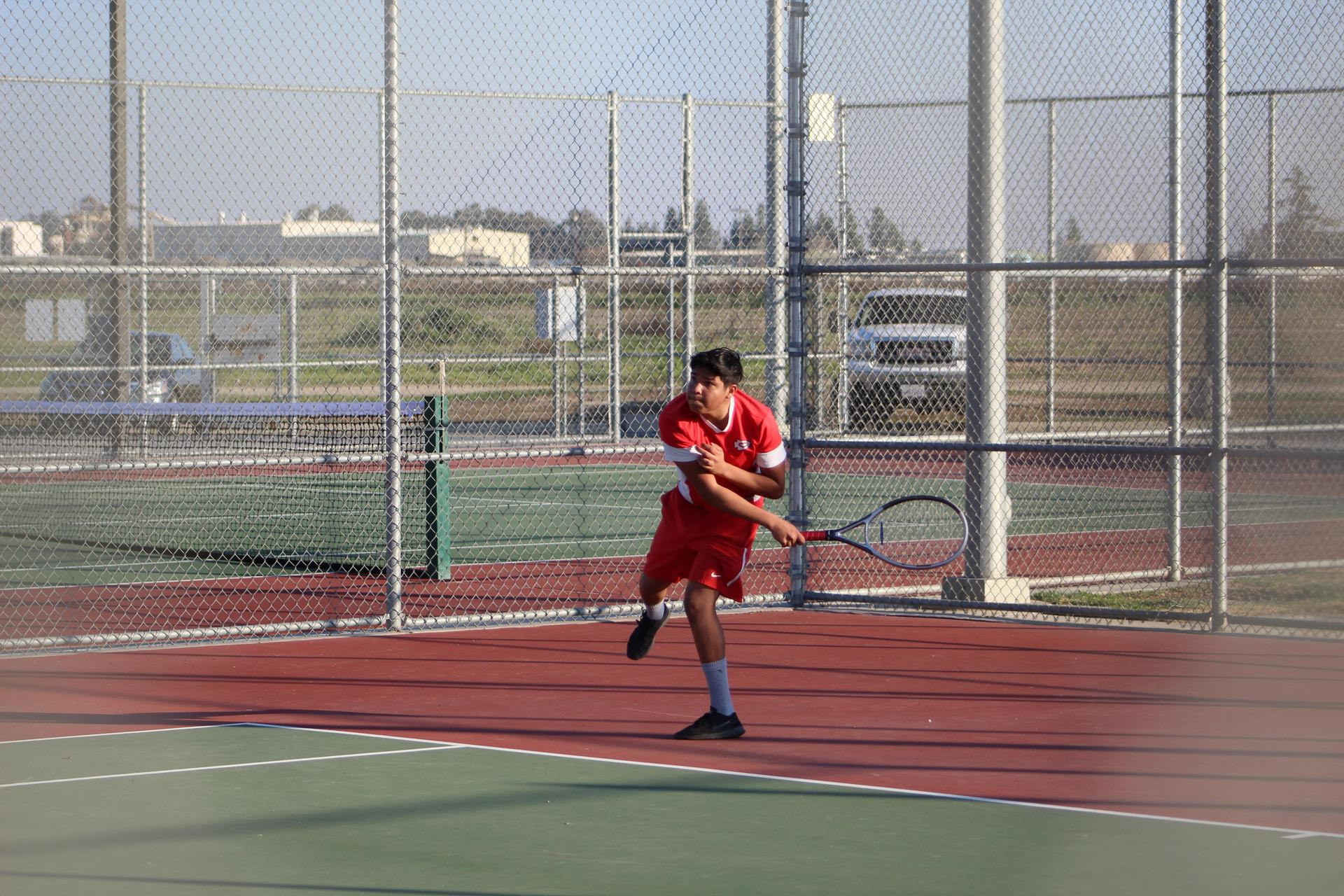 boys playing tennis against Roosevelt