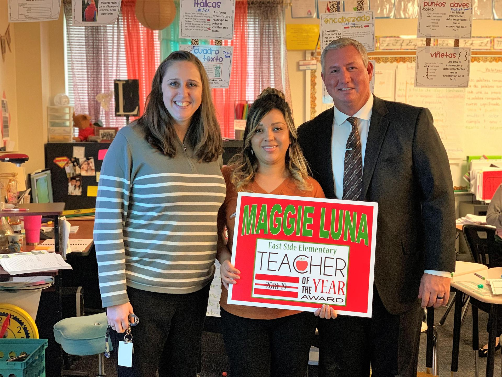 maggie luna with principal and superintendent