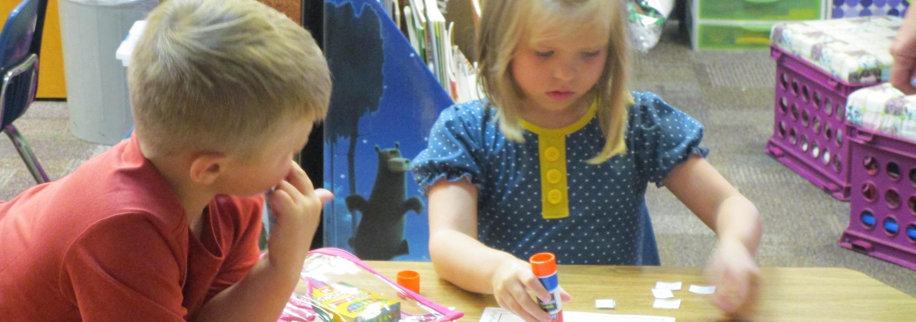 kindergarten working at tables