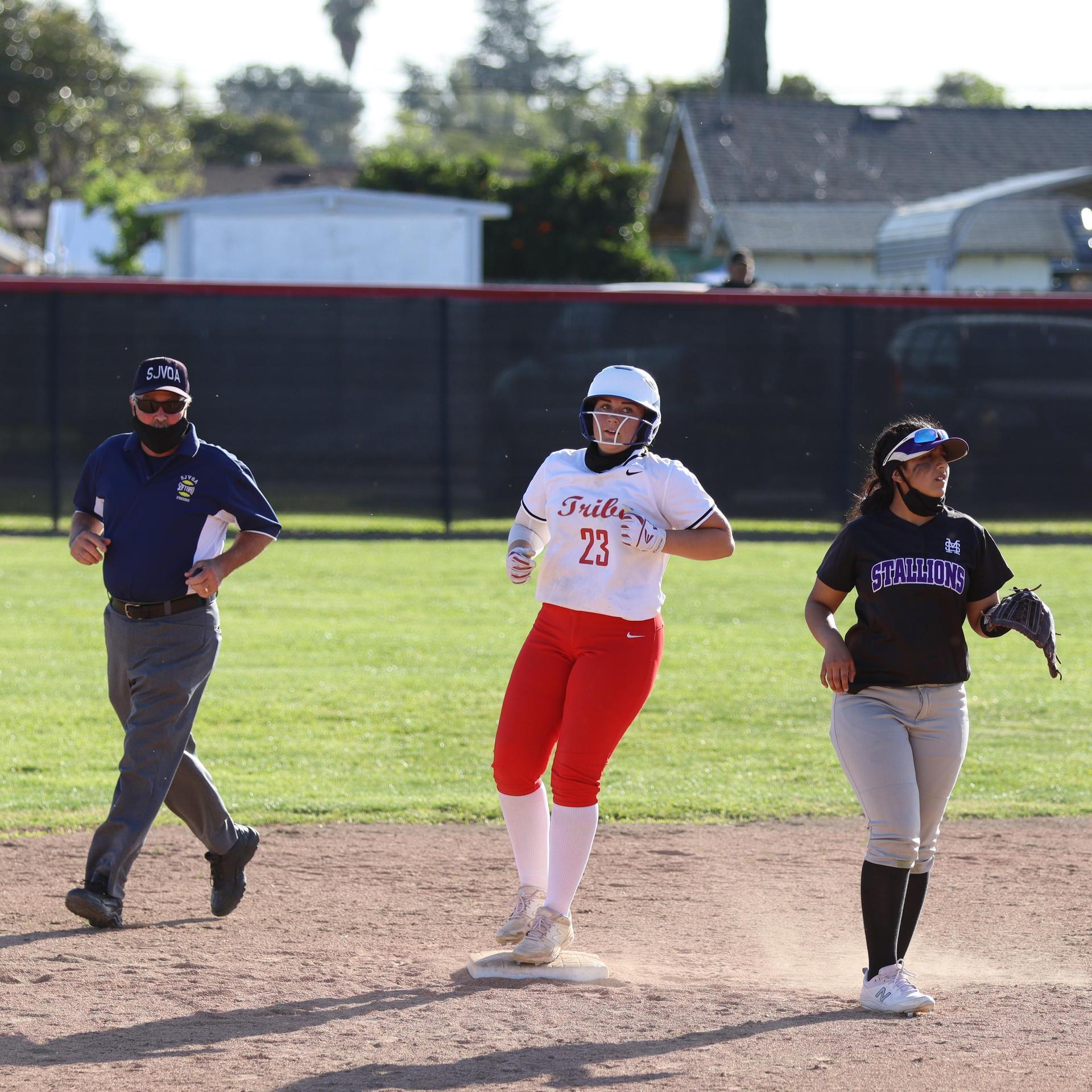 girls playing softball against Madera South
