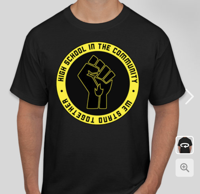 T-shirt with Black Power Fist in center surrounded by the words High School in the Community We Stand Together