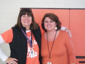 Staff members wear orange for