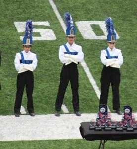 Westfield High School Marching Band drum majors (L-R) Noelle Shih, Matthew Robinson and Jessica Strauss perform with the marching band during the Bands of America Mid-Atlantic Regional Championship on Oct. 9 at the University of Maryland.