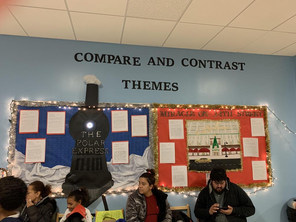 compare contrast bulletin board display of the polar express and miracle on 34th Street student work with parents sitting in front