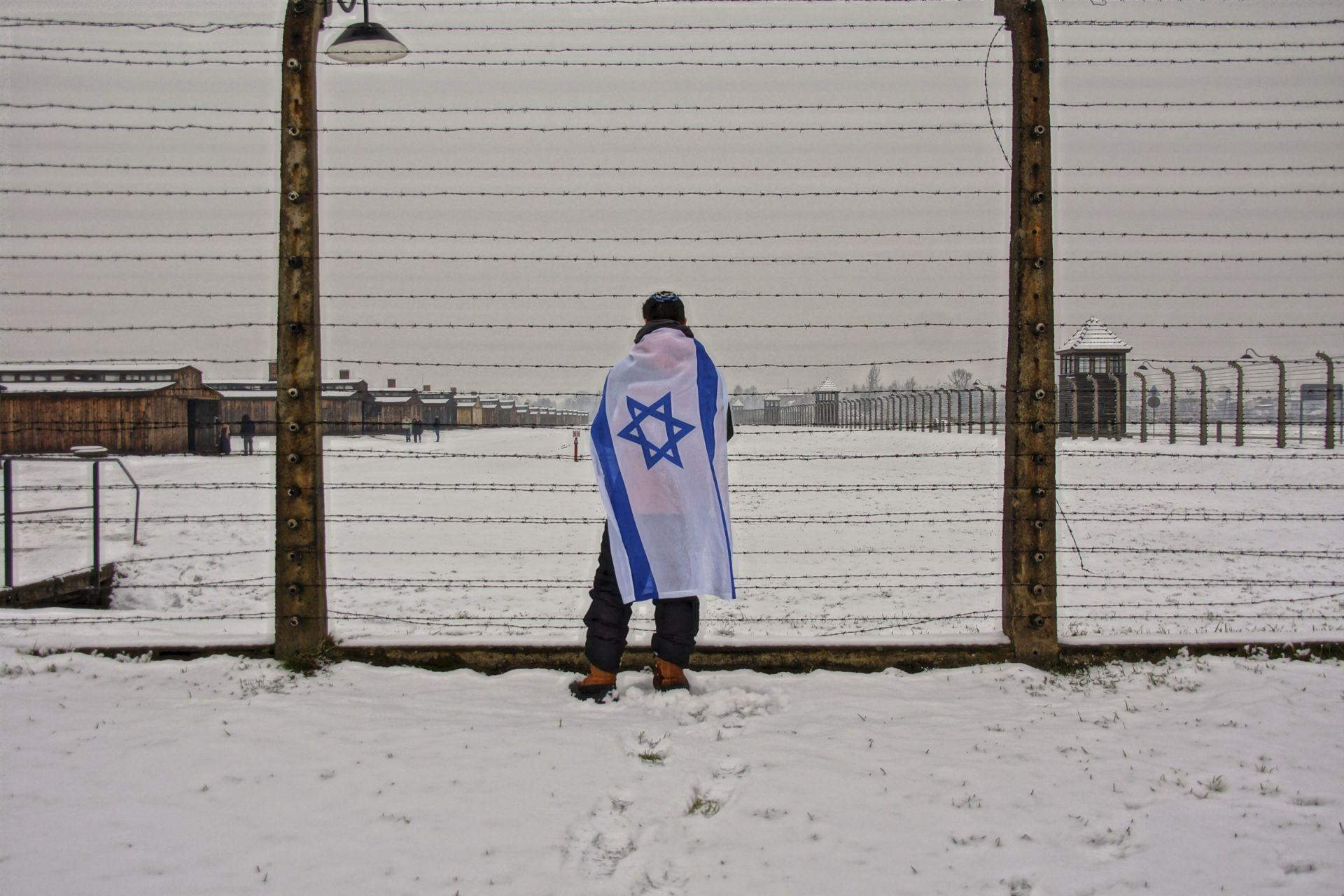 WHHS student with Israeli flag at Auschwitz
