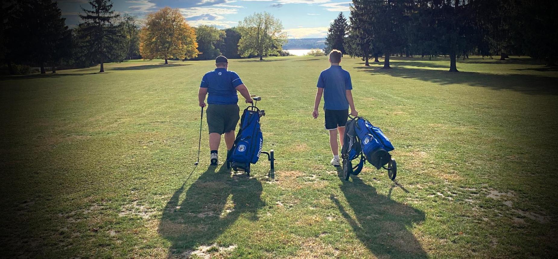 Honeoye golfers walking the field
