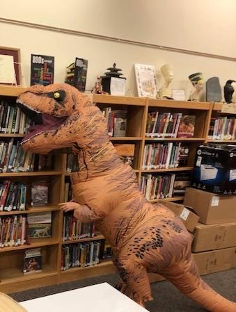 Dyno Enjoys Books