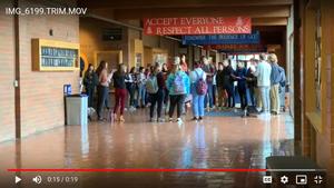 STUDENTS STANDING IN SCHOOL HALLWAY
