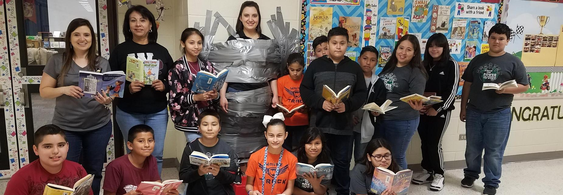 Teacher stuck on reading - taped to wall