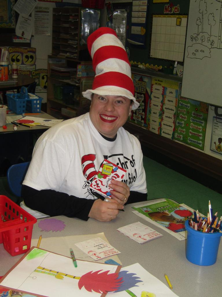 happy teacher wearing seuss tshirt