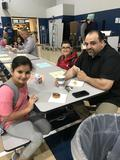 Student on Donuts with Dad's day