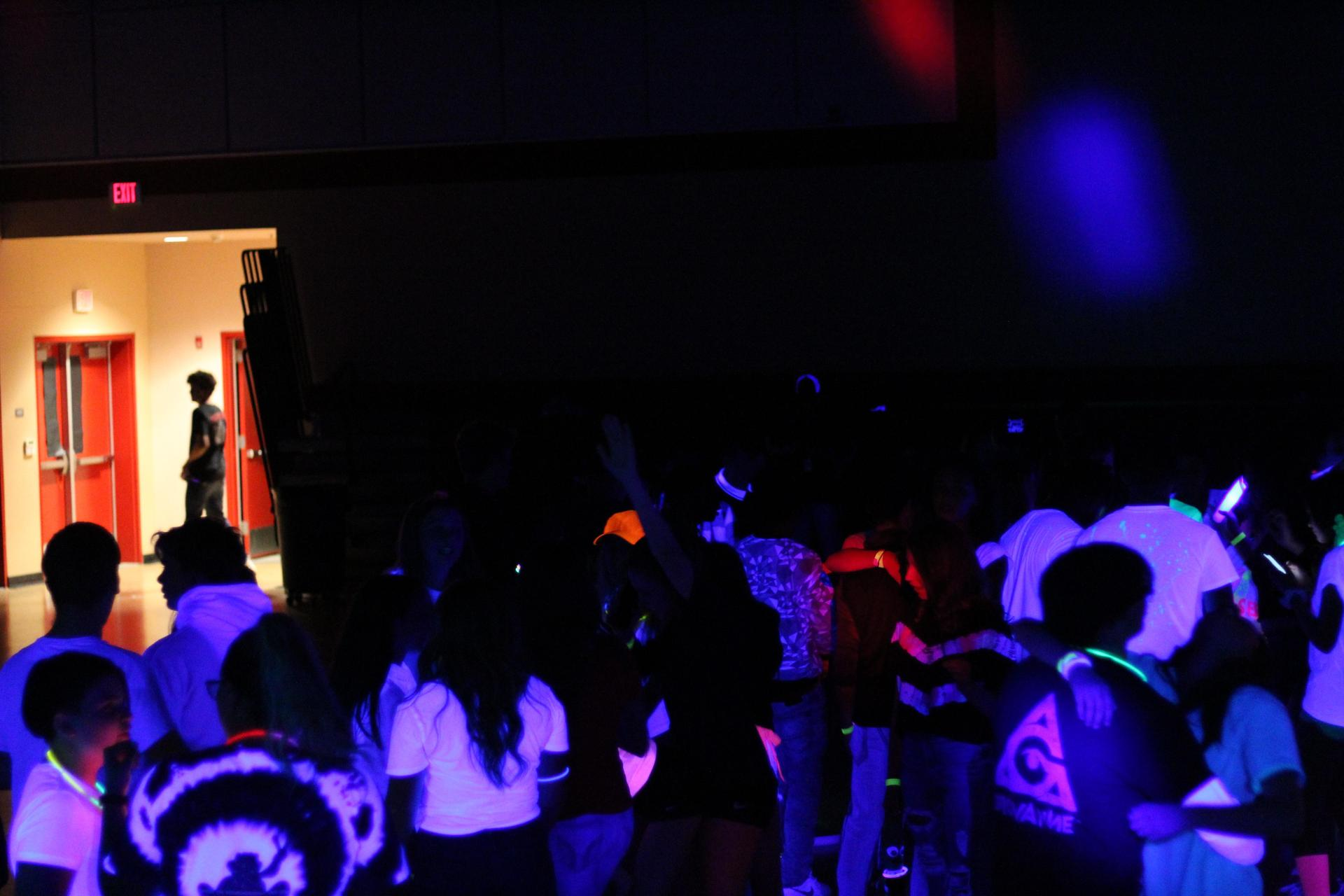 students enjoying the blacklight dance