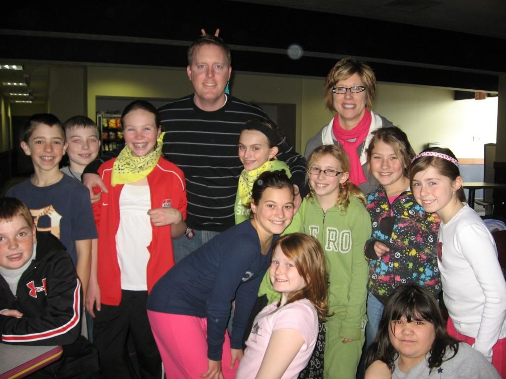 students pose for camera at bowling alley