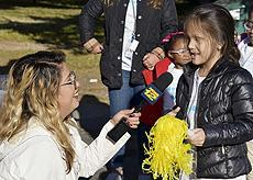 White Cane Day events. image of a young student being interviewed by News12