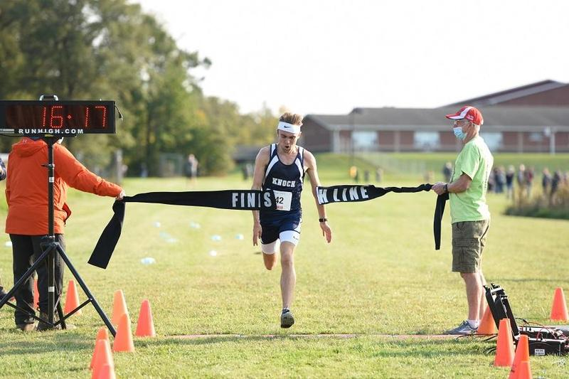 pic of Mike Formica crossing a finish line