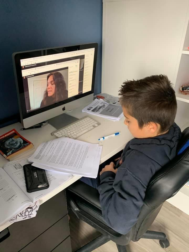 A student on a videochat with their teacher