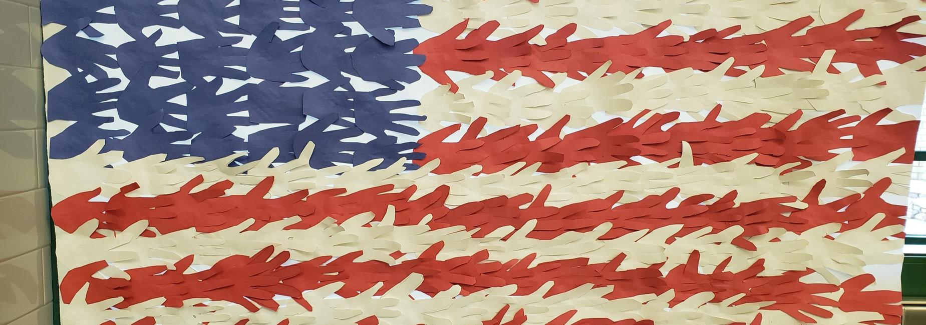 American flag made with student hand prints cut from red, white and blue paper