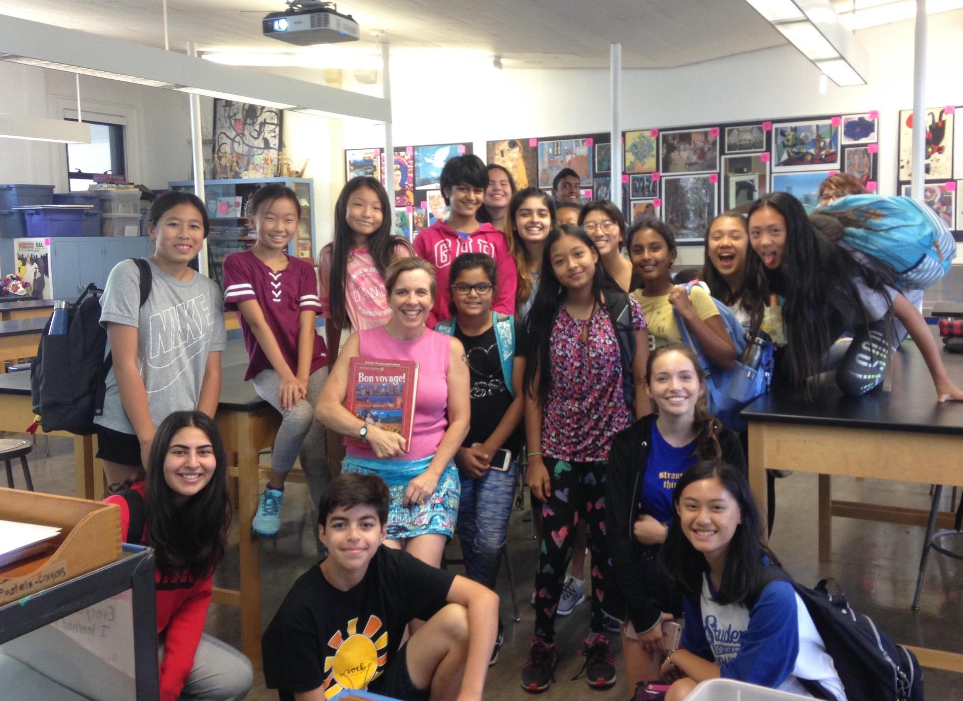Photo of AHS Teacher Christina Vaughan and First Avenue Middle School Students