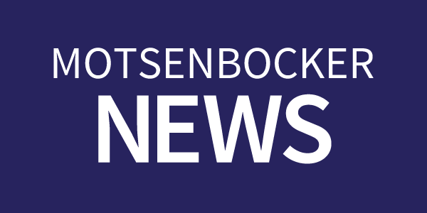 Motsenbocker news text on a dark blue rectangle button