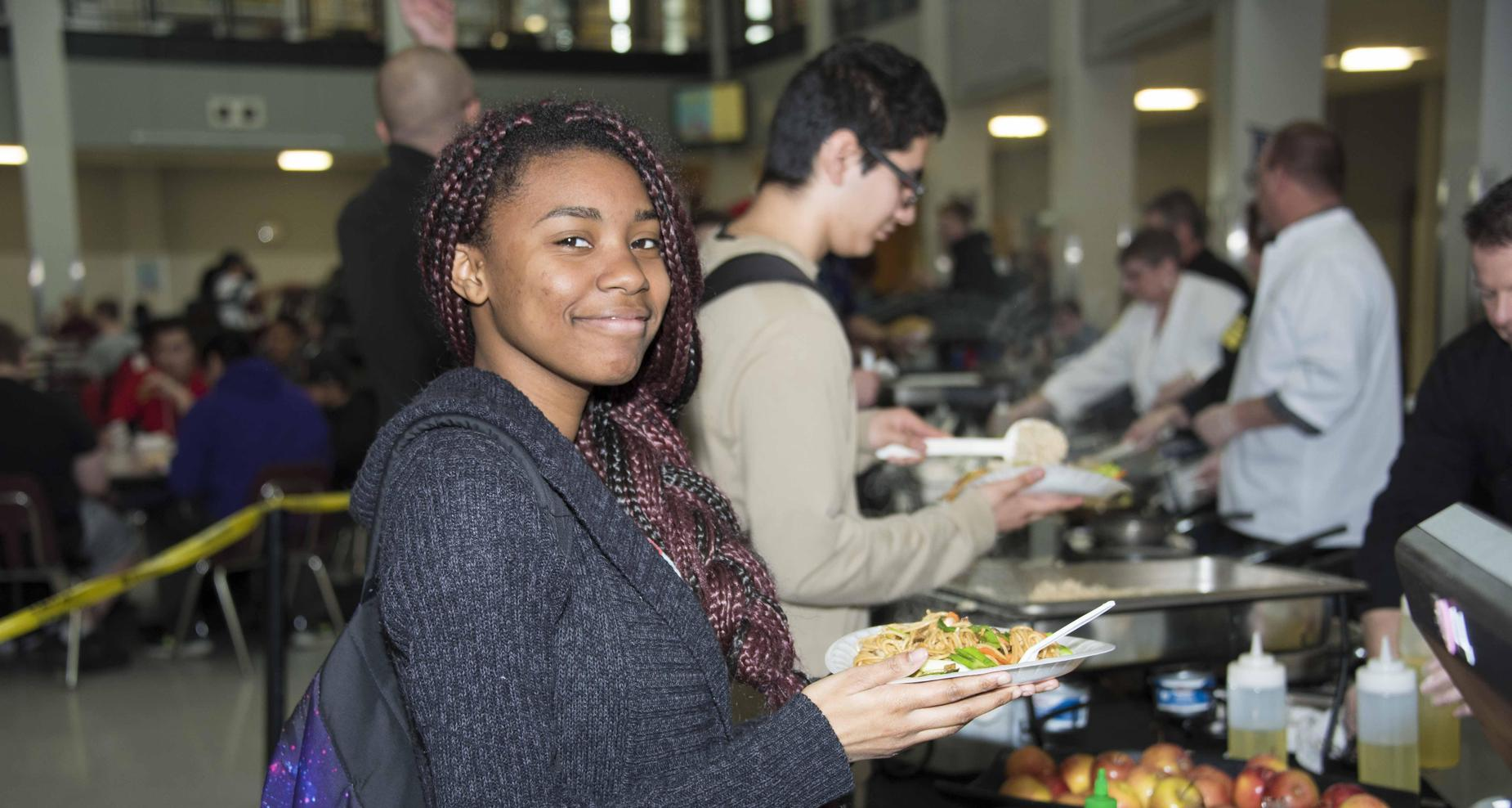 student smiling in lunch line