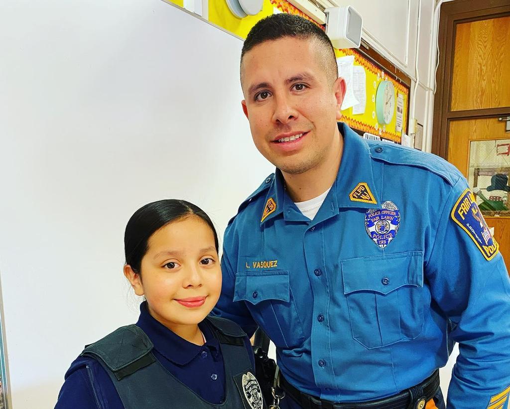 girl with officer Vasquez